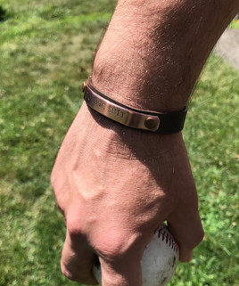 metal/leather combination Snarklet worn on man's arm
