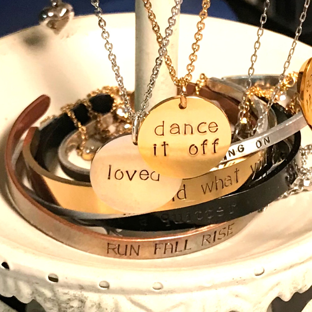 jewelry in a tray hand stamped necklaces with dance it off and loved mantra jewelry