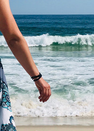 black stainless steel Snarklets on woman's arm at the beach
