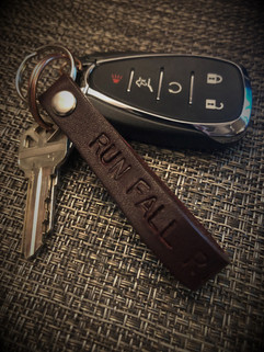 """mahogany leather Snarklets key ring hand stamped with """"run fall rise"""" from snarklets.net"""