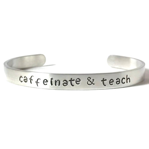 "aluminum mantra bracelet hand stamped with ""caffeinate & teach"" from Snarklets.net"