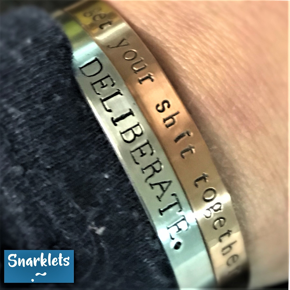 copper bracelet with get your shit together and aluminum bracelet with deliberate. hand stamped by Snarklets