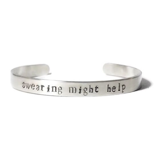 """Aluminum mantra bracelet hand stamped with """"swearing might help"""" from Snarklets.net"""