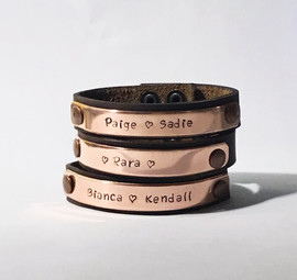 Copper on brown leather hand stamped Snarklets available at snarklets.net