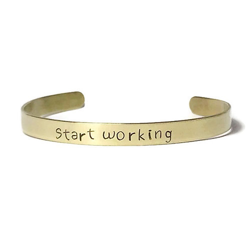 """Brass mantra bracelet hand stamped with """"start working"""" from Snarklets.net"""