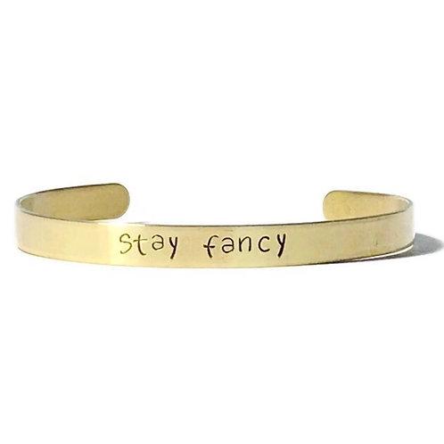 "Brass mantra bracelet hand stamped with ""stay fancy"" from Snarklets.net"