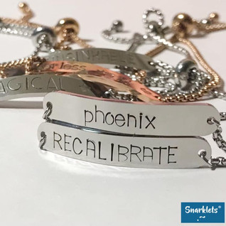 """Snarklets bolo bracelets hand stamped with """"phoenix"""" and """"recalibrate"""" available at snarklets.net"""