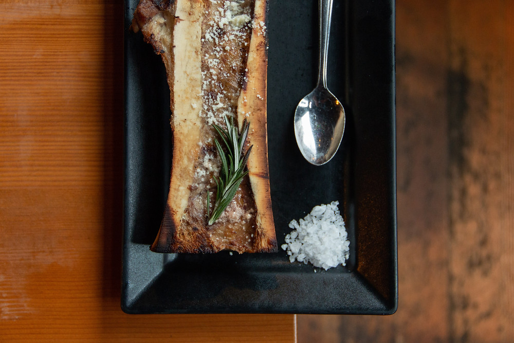 Tuetanos, fire roasted extra long bone marrow canoe with cotija cheese and crostinis