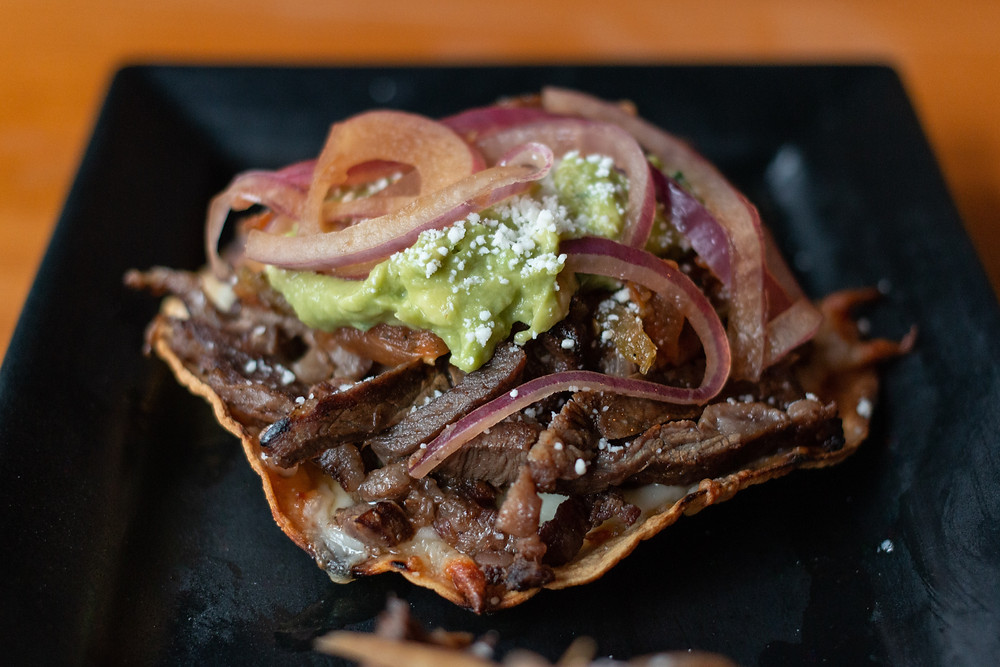 Vampiros, two mesquite smoked tostadas with melted asadero cheese and steak