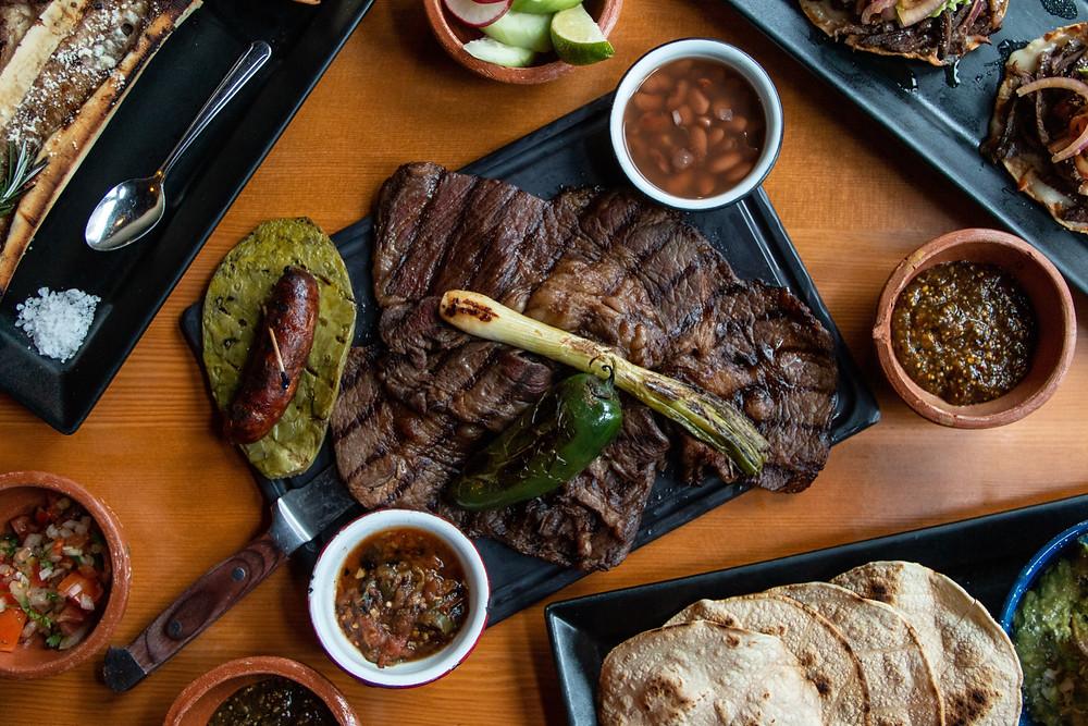 La Carne Asada Wagyu, 16oz carne asada platter wagyu chuck eye ultra grade thin cut, served with nopal, and chorizo