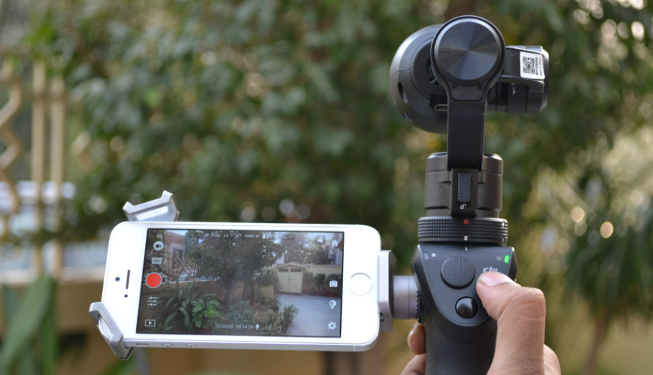 dji osmo + seen in a garden using with a phone