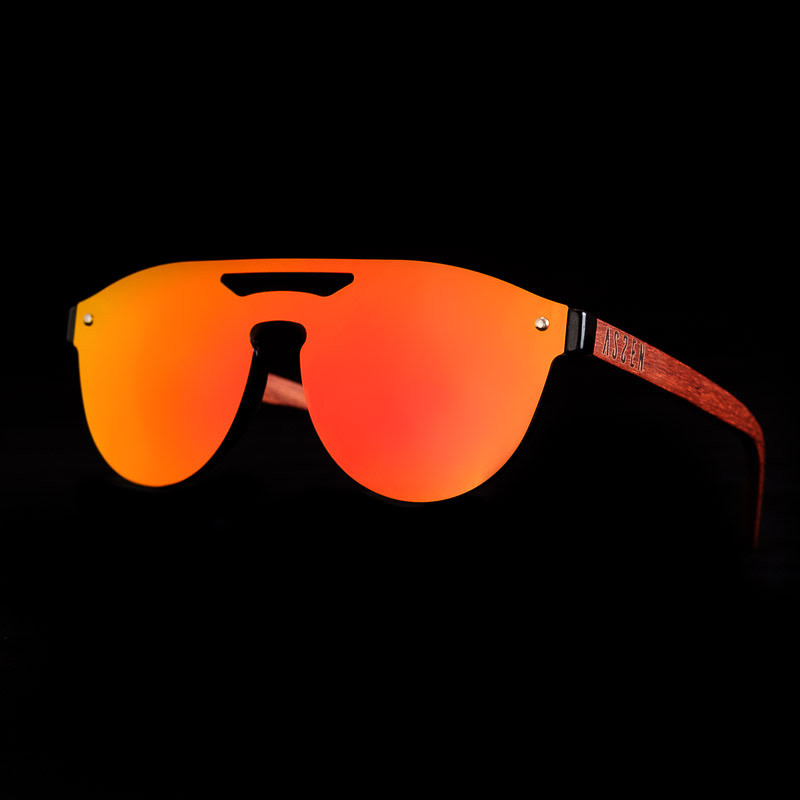 red sunglasses with double bridge on a black background