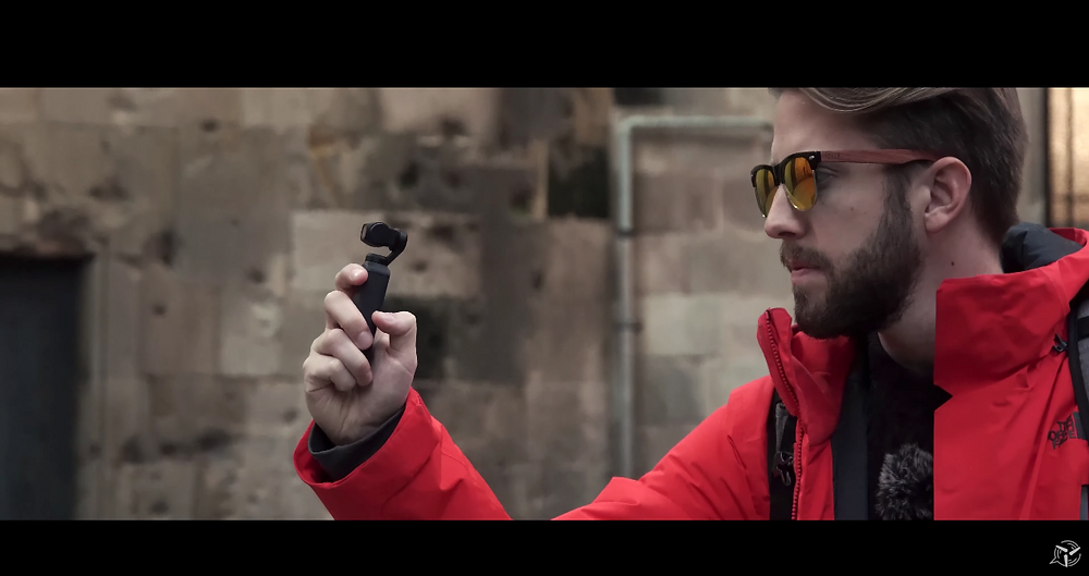 Alex testing the DJI Osmo Pocket in Barcelona wearing sunglasses
