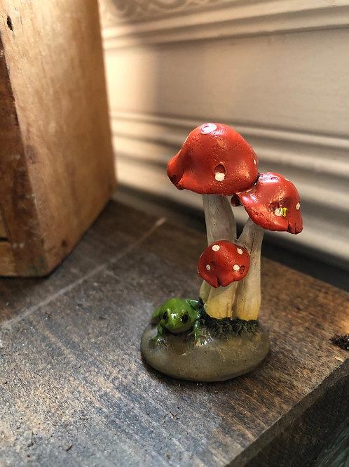 Hiding under the mushrooms
