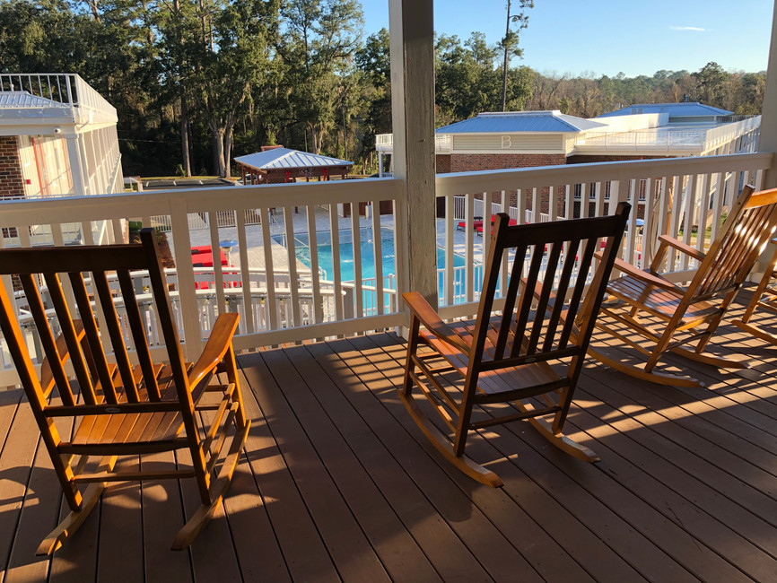 Rocking Chairs Overlooking Our Resort-Style Pool