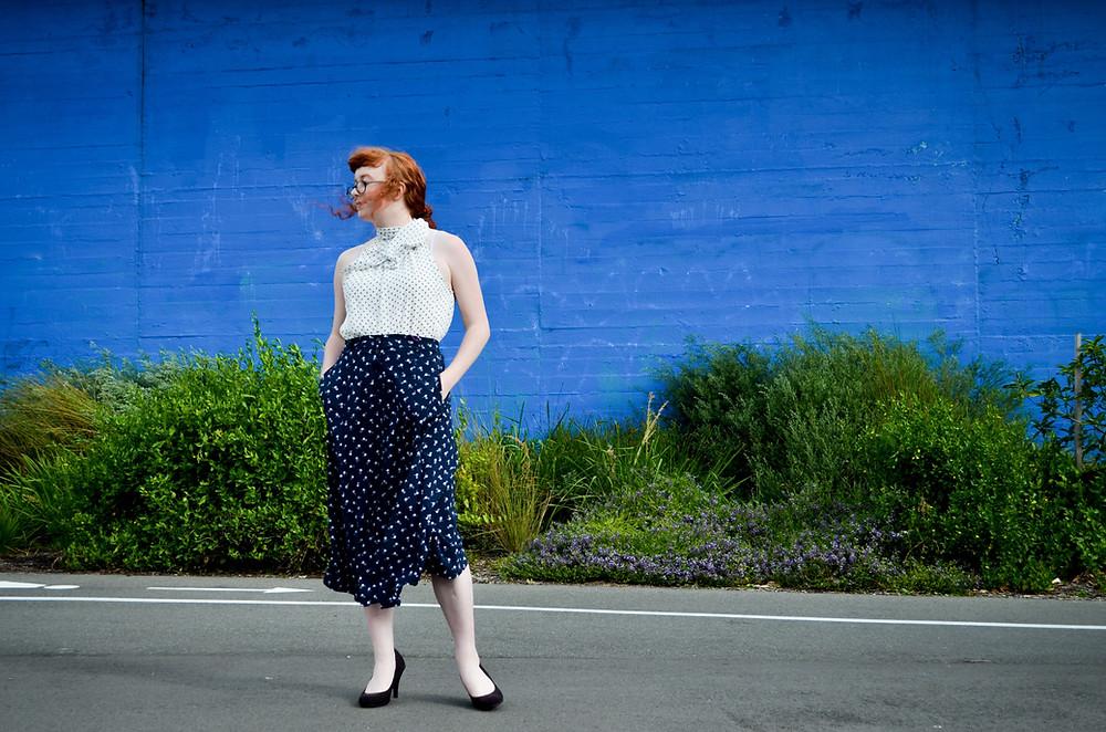 Woman Near Blue Wall