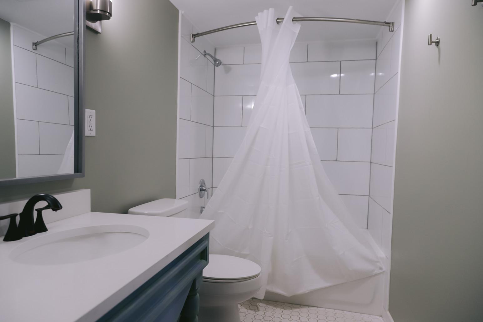 Large Tile 'Luxury' Bathrooms In Every Room