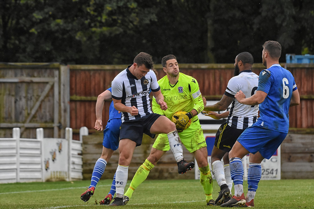 Martin Horsell under pressure by the Farnborough side