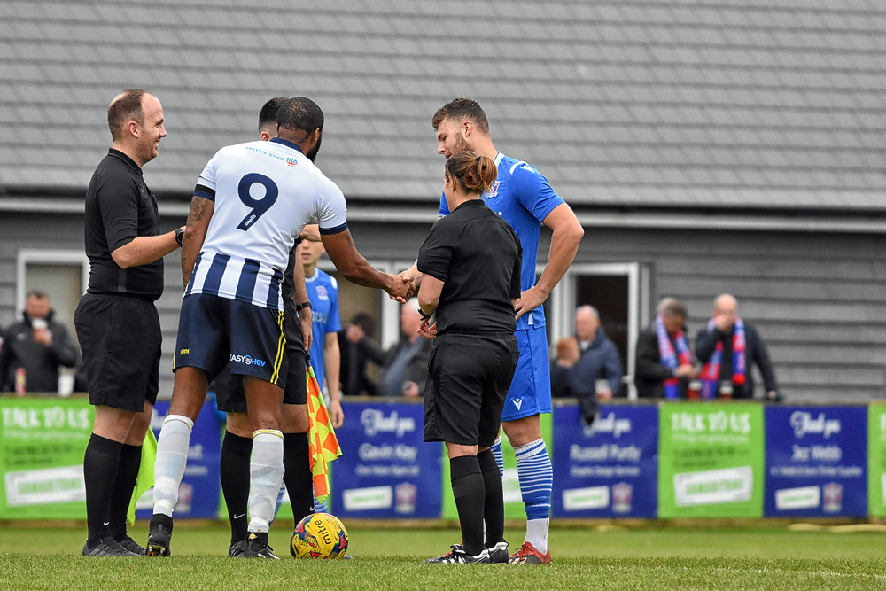 Two captains shaking hands before the start of the non league game Swindon supermarine fc Vs Farnborough Fc