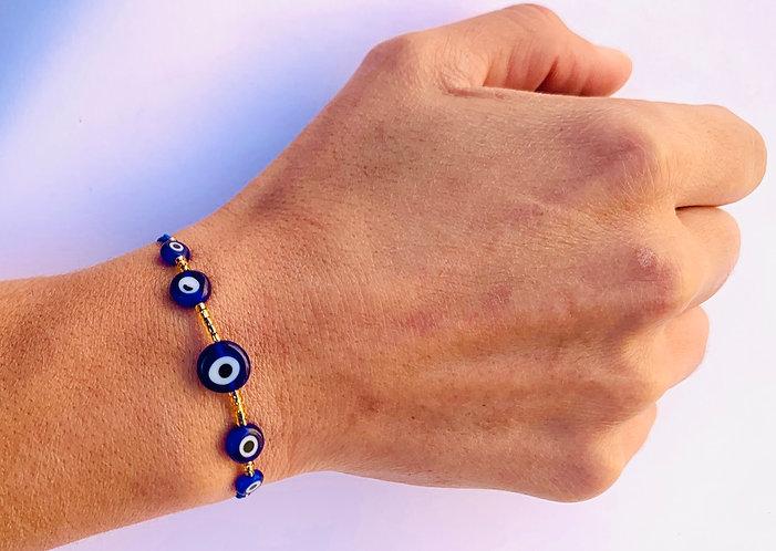 Bracelet Oeil bleu sur Cordon coloré ajustable