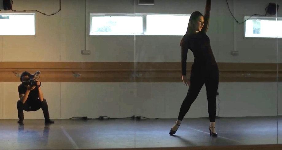 Artist filming dancer in dance studio