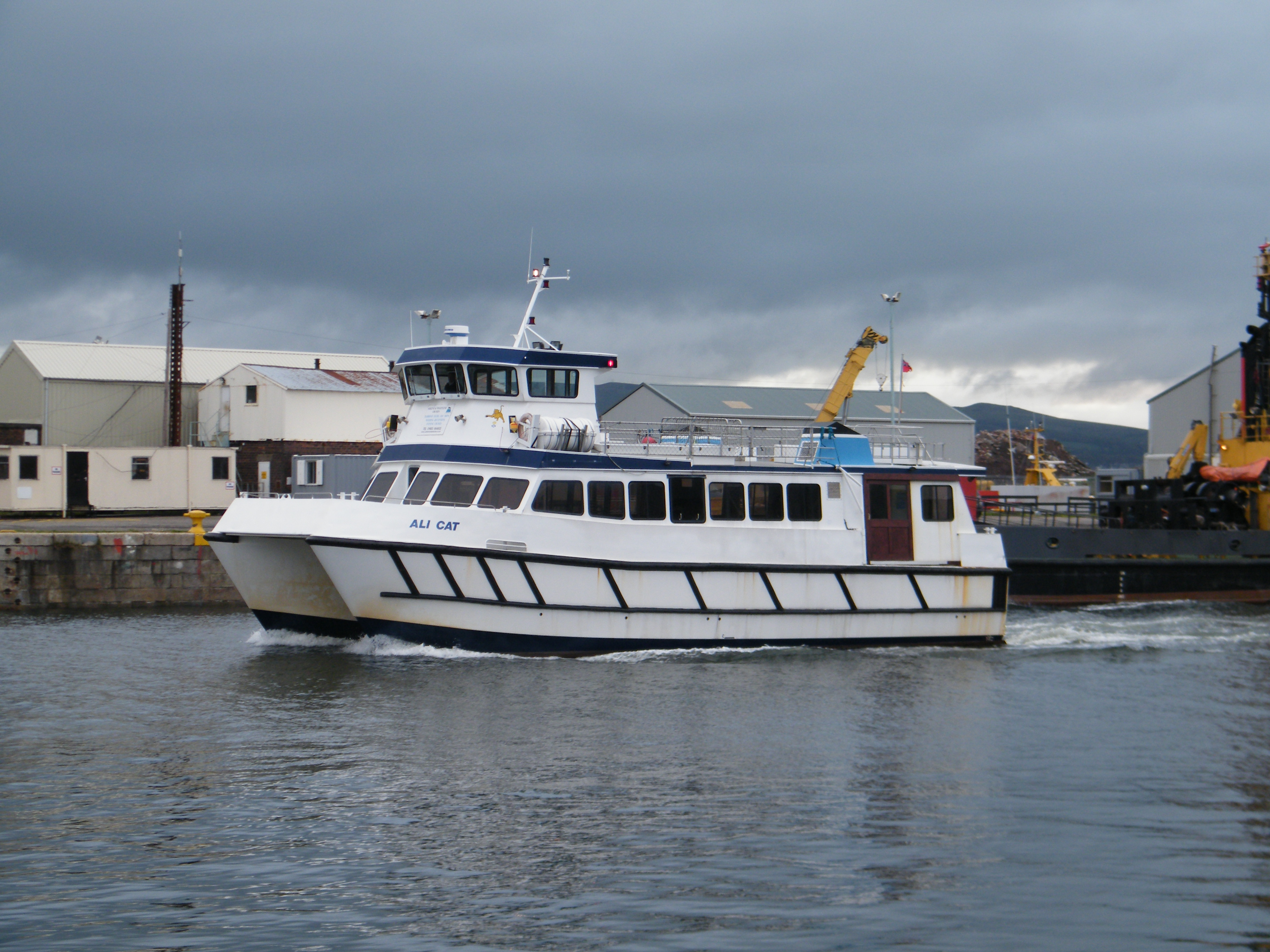 Ali Cat in original colours leaving the James Watt Dock for service (Ships of CalMac)