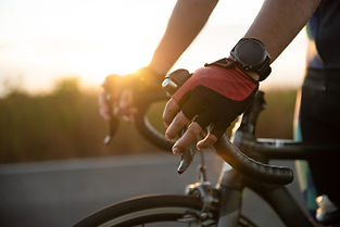 hands-gloves-holding-road-bicycle-handle