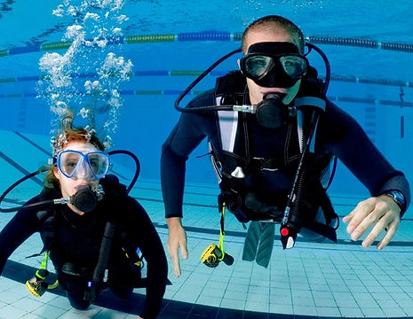 practicing scuba in the swimming pool