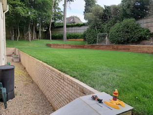 Great Turfed Lawn area with Wall and Flower Beds