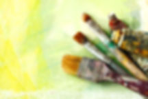 Vintage artists brushes and paint tubes