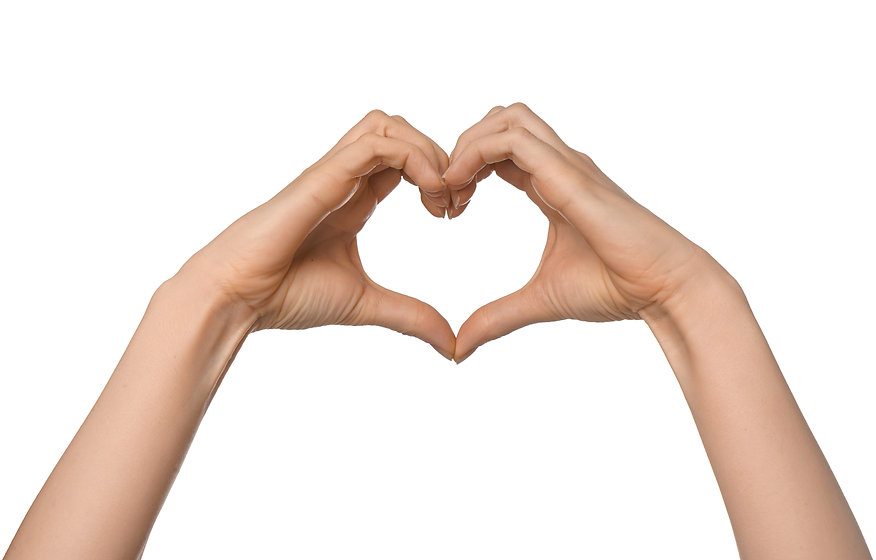 Woman making heart with her hands on whi