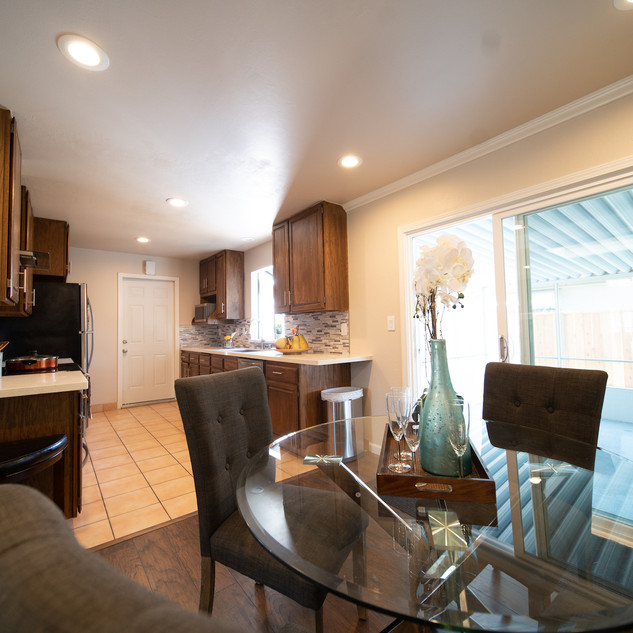 Open concept kitchen and dining room with new recessed lights