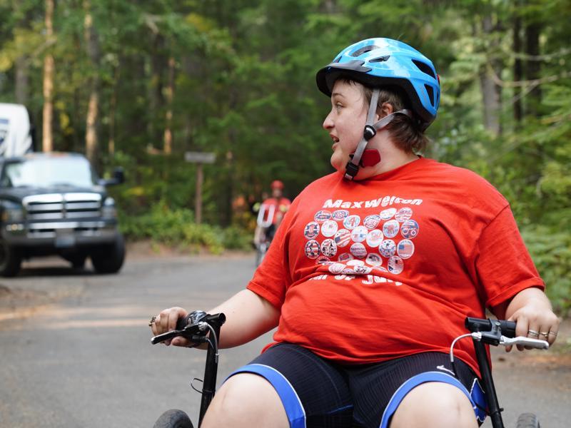Developmentally Disabled Adult Woman uses bike/wheelchair on trail in Leavenworth, WA.