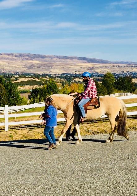 A developmentally disabled man rides a horse at Alatheia Riding Center