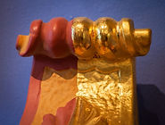 This korbel is finished to demonstrate bole and gold leaf application steps used in gilding