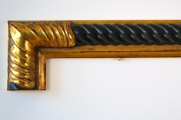 Laurel leaf and twist. Carved and water gilded with black painted twist