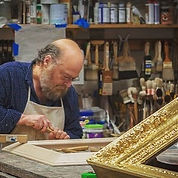 Peter Miller hand carves an art frame
