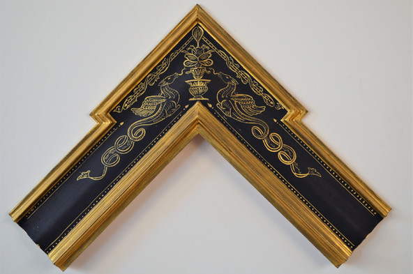 Reverse ogee with extended corner. Water gilded with egg tempera sgraffito.