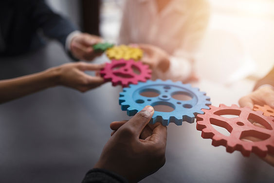 Business team connect pieces of gears. T