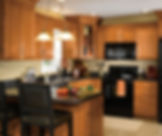 maple_wood_cabinets_in_traditional_kitch
