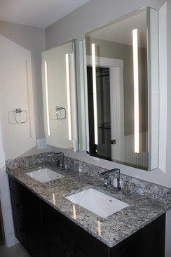 Lemiuex bathroom, designed by Nathan Johnson. Dover, NH. Featuring dark cabinet vanity with his and her rectangle sinks, and grey and white granite countertop.