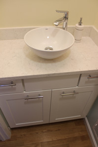 Berk second bathroom, designed by Patty Heath. Featuring off-white cabinets, white quartz countertop, and vessel sink.
