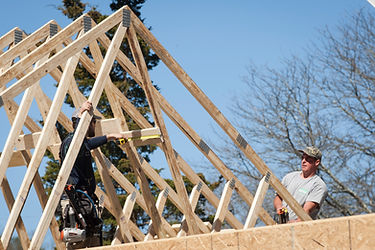 Image of workers installing roof joists
