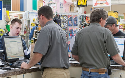 Image from behind the counter of Cramer's staff serving customers.