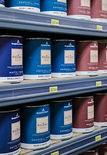Paint cans displayed on shelf