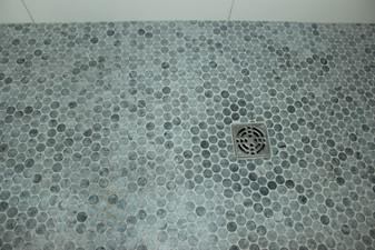 Marble tile grout details on master bathroom shower, designed by Nathan Johnson.