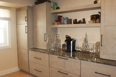 Basement bar and storage designed by Patty Heath, Newcastle NH.