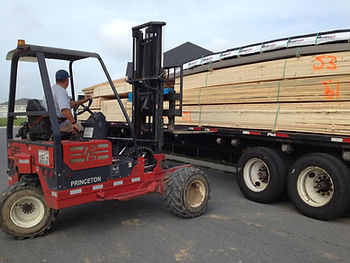 Forklift loading a delivery truck