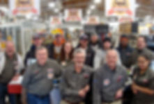 Image of Cramer's employees inside store with 100th Anniversary signs hanging from ceiling.