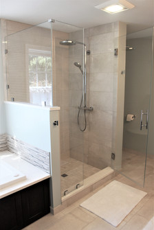 Berk Bathroom, designed by Patty Heath. Featuring a glass shower with stone floor and backsplashes.